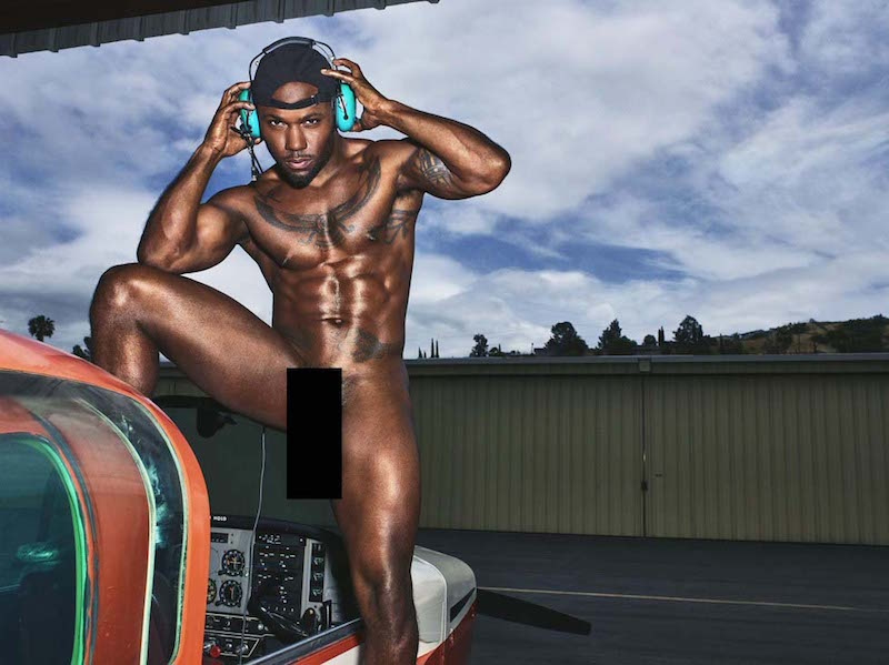 Milan Christopher nude with one leg in an airplane cockpit