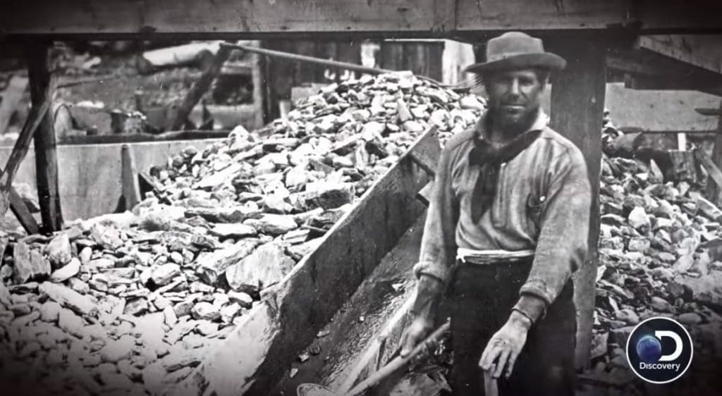 A historical photo of a gold prospector in Devil's Canyon