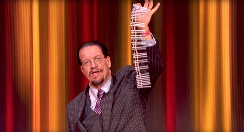 Penn Jillette holds up a string of nails on Superhuman
