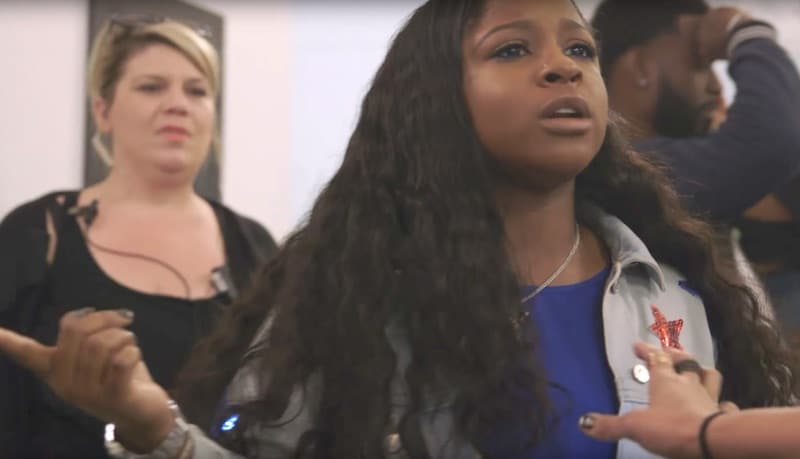 And angry looking Reginae Carter pointing at Brandon Barnes off screen on Love and Hip Hop: Atlanta
