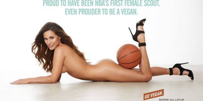 Bonnie-Jill Laflin lying on her front naked holding a basketball with her leg in an ad for PETA