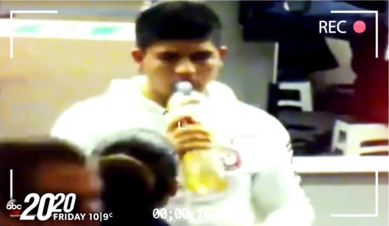Cruz Velazquez Acevedo drinking from a bottle containing yellow liquid at border check