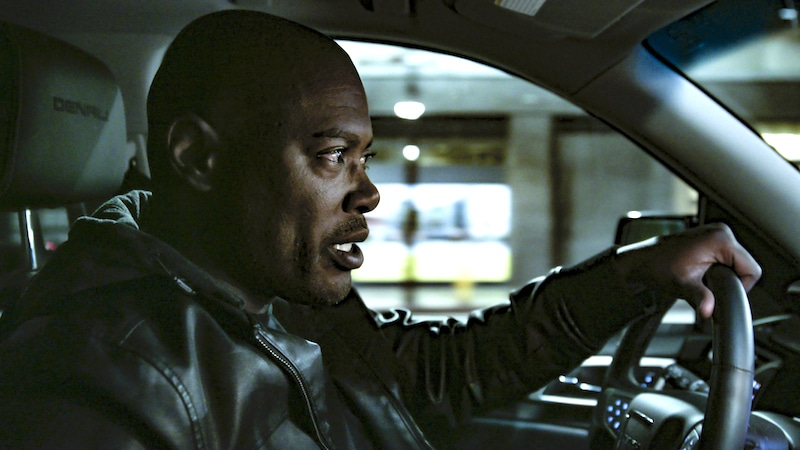 Akil Muhammad of Akil The Fugitive Hunter driving a car