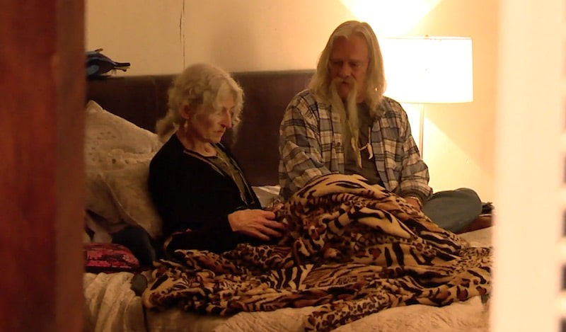 Ami Brown and Billy Brown talking on a bed on Alaskan Bush People