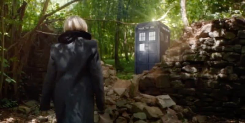 The new doctor walks through some woods to the TARDIS