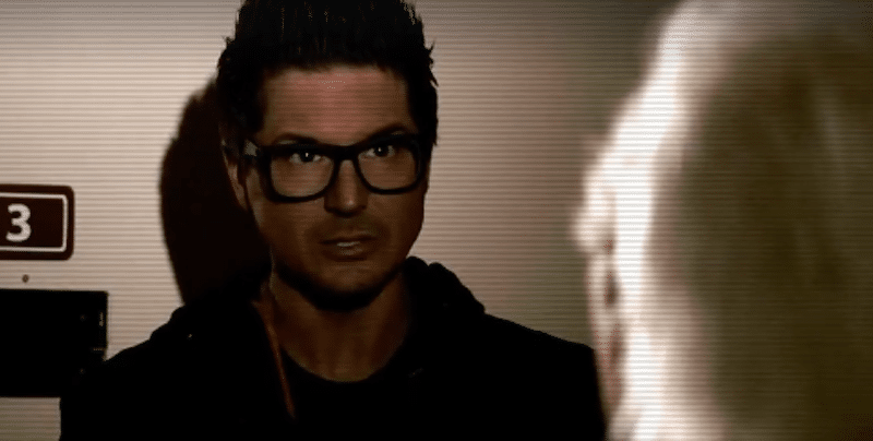 ZAk Bagans talks with a former nurse at Asylum 49 in a dark corridor