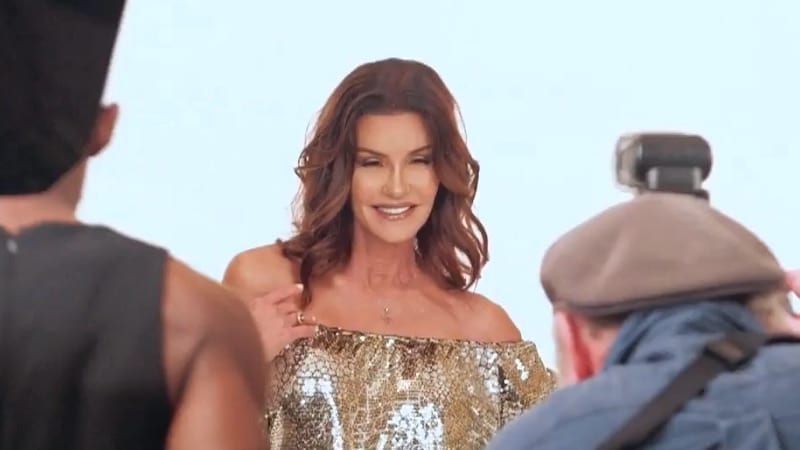 Janice Dickinson posing for photos in a silver sequinned romper