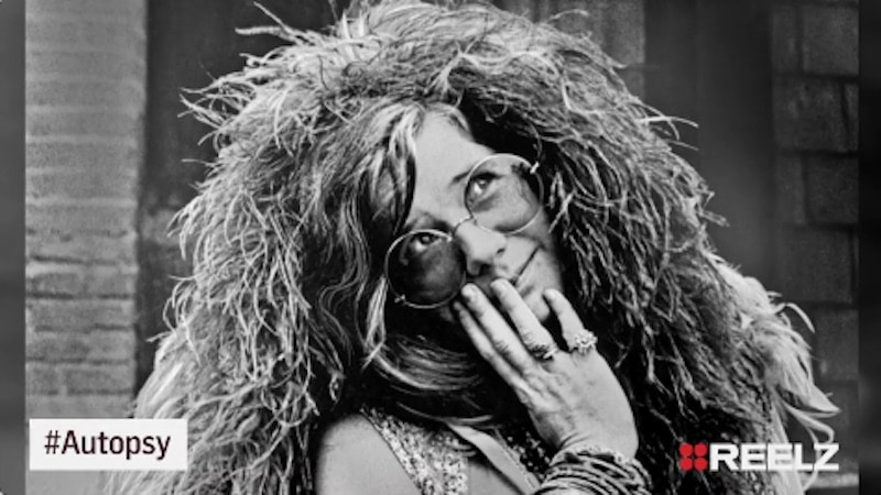 Janis Joplin posing for a photo
