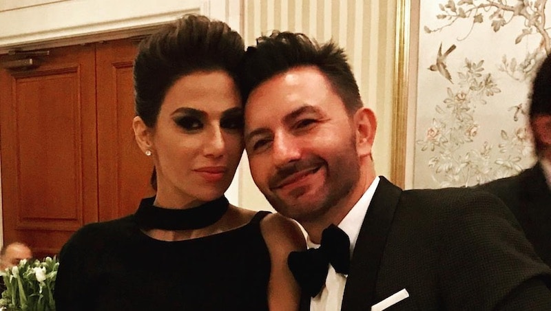 Peggy and Diko Sulahian posing together in black tie dress