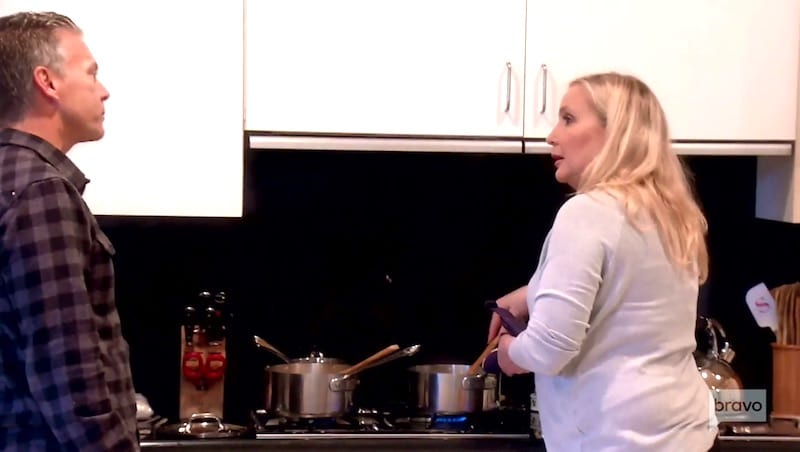Shannon cooks quinoa for dinner while David stands beside her