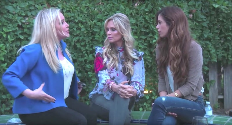 Shannon gestures at her belly as Tamra Judge and Lydia McLaughlin look on