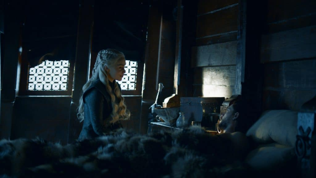 Dany comforts Snow who is thawing out