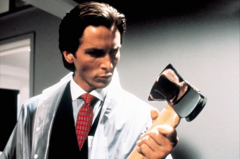 Christian Bale holding an axe in American Psycho