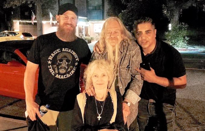 Ami smiling in a wheelchair with Billy Brown and two Alaskan Bush People fans stand behind her