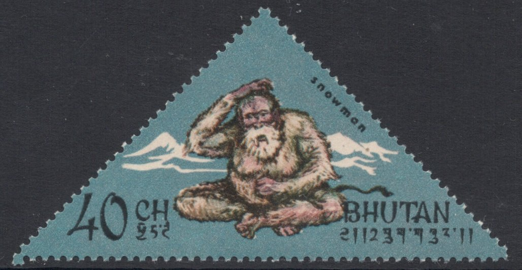 A triangular Bhutanese stamp featuring a cross-legged Yeti