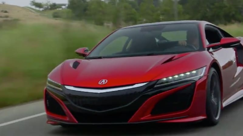 Jay driving the Acura, external shot and red car