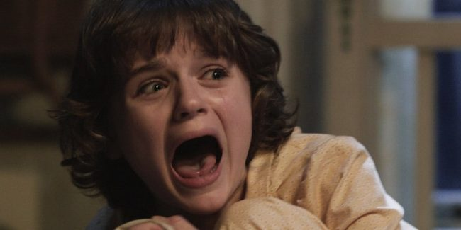 Joey King cowering and screaming in The Conjuring