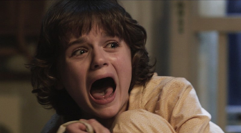 Joey King cowering and screaming in The Conjuring, among our list of the best ghost movies