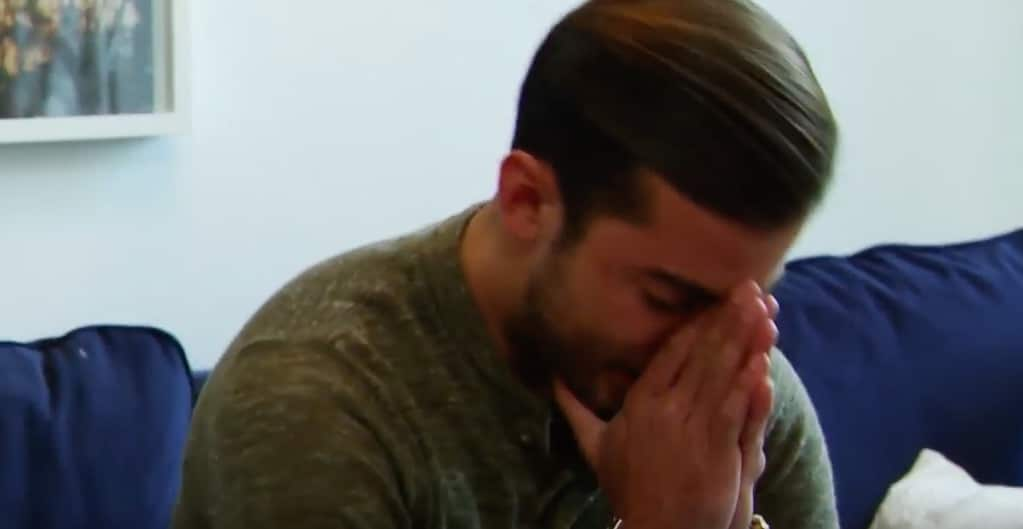 Luis breaks down in tears with his head in his hands