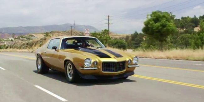 Gold 1971 Camaro on the road in desert