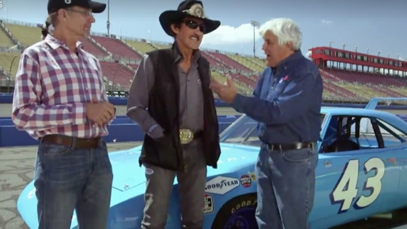 Richard and Kyle Petty talk to Jay on the race track