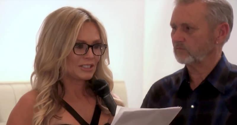 Tamra Judge crying as she gives a talk standing next to her father