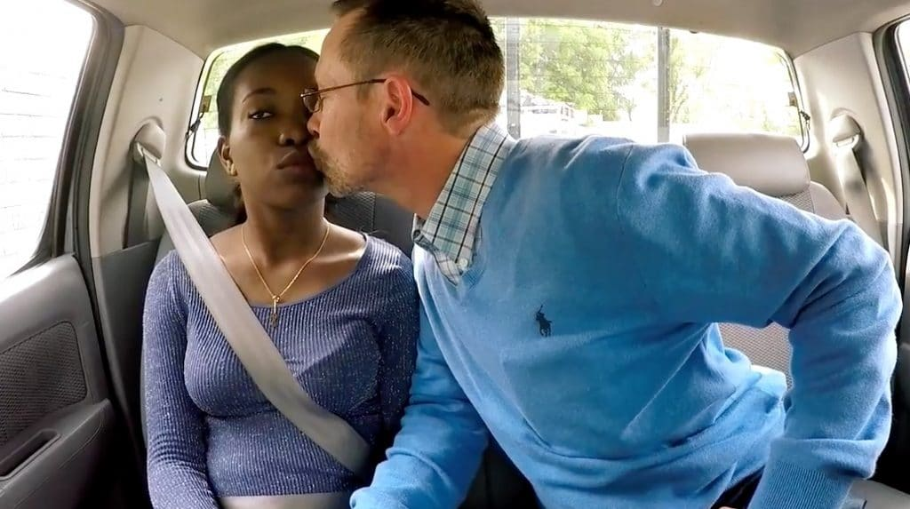 Sean leans to kiss Abby in back of car