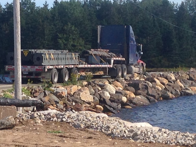 A truck crosses the Oak Island causeway
