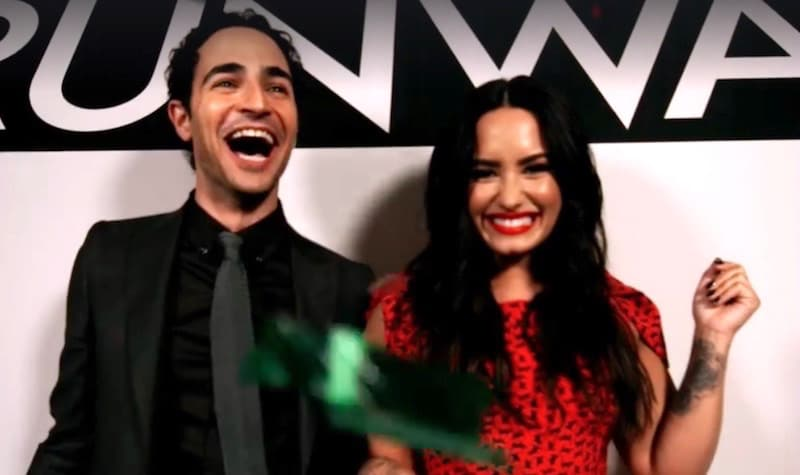Zac Posen and Demi Lovato in a still from a Project Runway clip