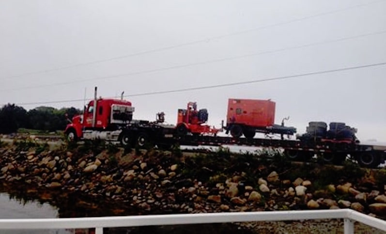 Trucks crossing the Oak Island causeway