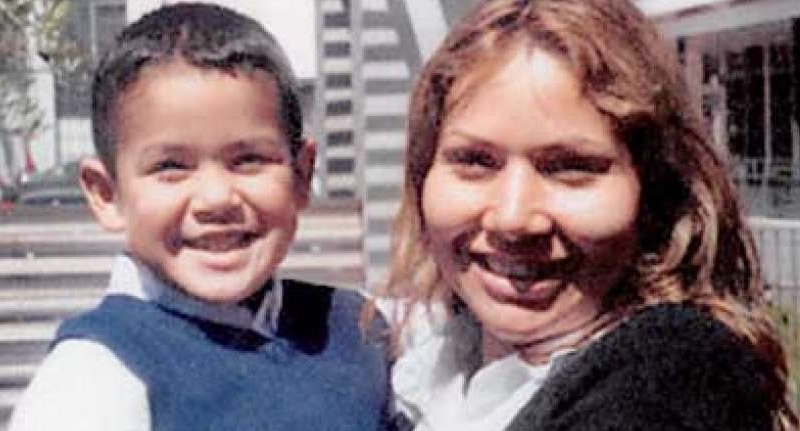 Evelyn Hernandez and her son in family photo, both smiling to camera