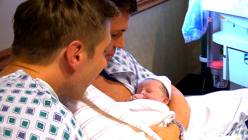 Jeff and Gage holding baby Monroe in hospital on Flipping Out