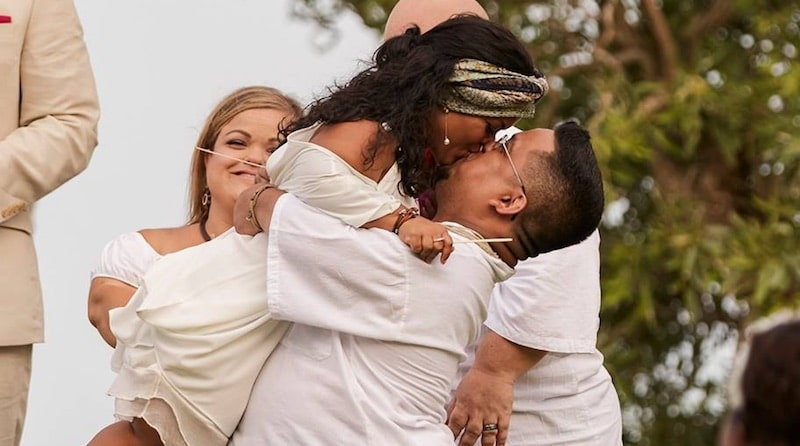 Jazmin Lang jumps into David's arms at the vow renewal ceremony on Little Women: Couples Retreat