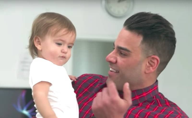 Mike Shouhed holding a baby on Shahs of Sunset