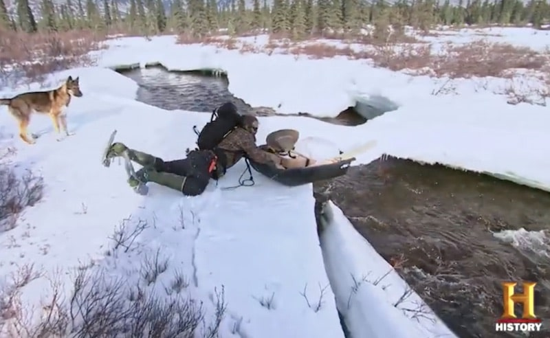 Morgan trying to stop his sledge and packages falling into the creek