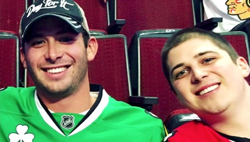 Below Deck star Nico and his brother Tristen at a hockey game