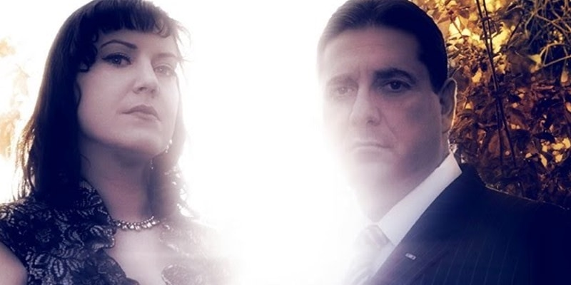 The Dead Files are headed to West Virginia, Steve and Amy pictured here with a strong light behind them.