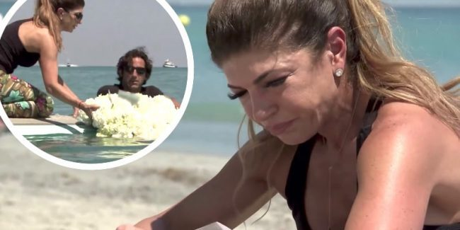Teresa Giudice crying on a beach and releasing a wreath of white roses at sea