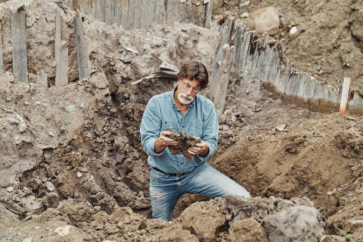 Rick Lagina looking at something inside an excavated hold on The Curse of Oak Island Season 5