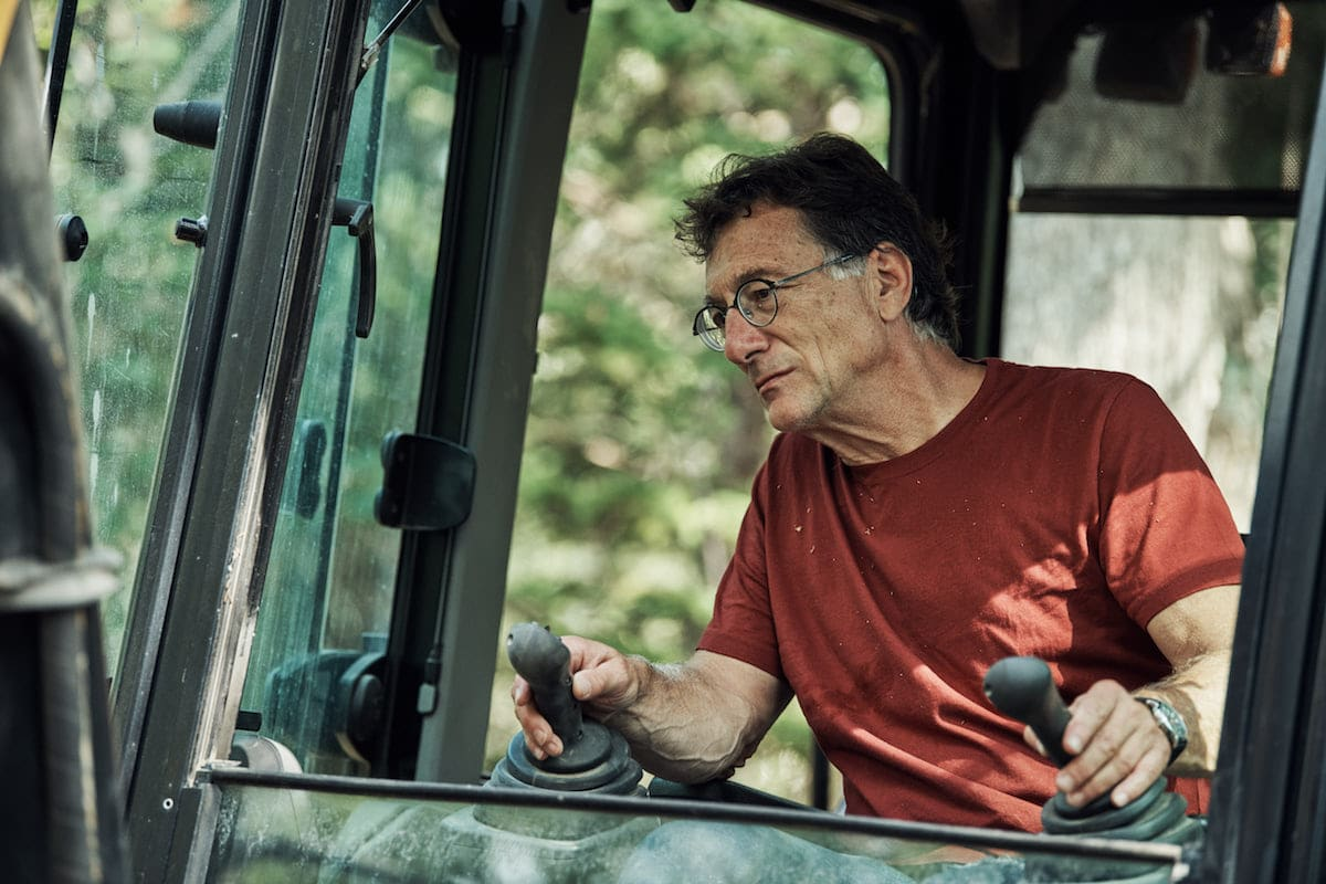 Marty driving an excavator on on The Curse of Oak Island Season 5