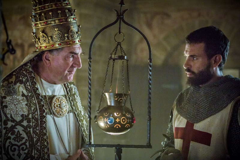 Pope Boniface VIII of France (Jim Carter) and Templar Knight Landry (Tom Cullen) from HISTORY's New Drama Series Knightfall.