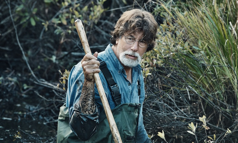 Rick Lagina standing in the swamp with a shovel on The Curse of Oak Island Season 5