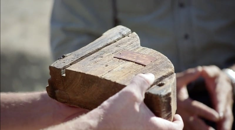 Matty Blake holding a piece of wood with grooves in