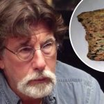 Rick Lagina and a fragment of human bone on The Curse of Oak Island