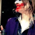 Bear Brown holding knife dressed as Joker