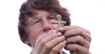 Rick Lagina holding a cross on The Curse of Oak Island