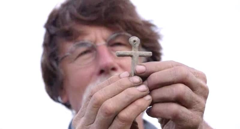 Rick Lagina holding a cross on The Curse of Oak Island