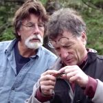 Rick and Marty Lagina examining keyhole