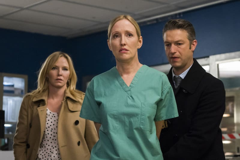 """Kelli Giddish as Detective Amanda Rollins, Janel Moloney as Dr. Lorraine Franchella and Peter Scanavino as Dominick """"Sonny"""" Carisi"""