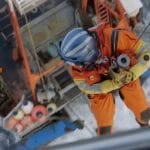 The rescuer heads down from the chopper on Deadliest Catch